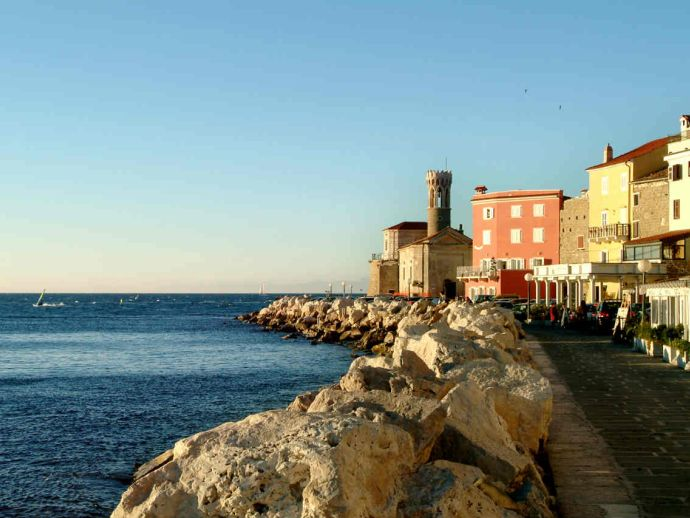 Piran is known for its long pier and Venetian architecture